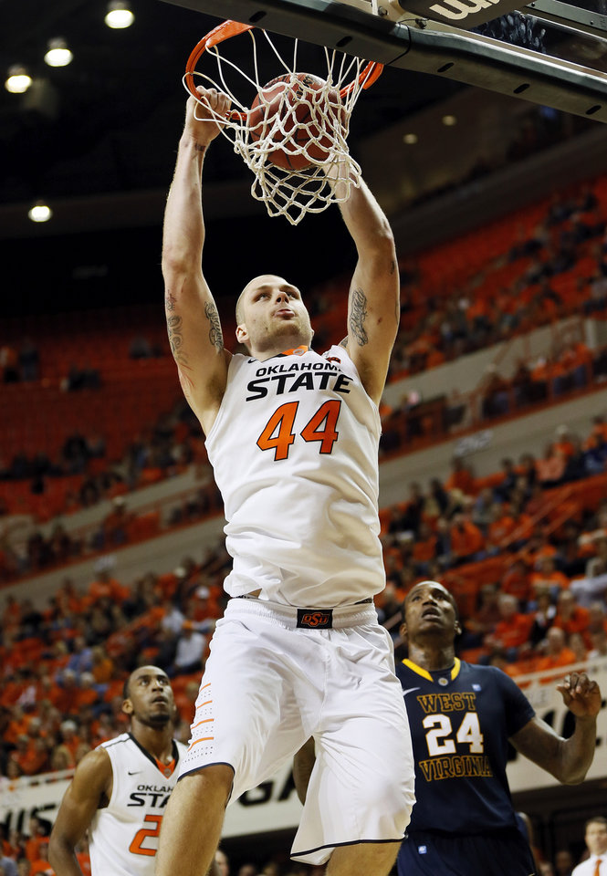 Photo - Oklahoma State's Philip Jurick (44) dunks the ball during an NCAA men's basketball game between Oklahoma State University (OSU) and West Virginia at Gallagher-Iba Arena in Stillwater, Okla., Saturday, Jan. 26, 2013. Oklahoma State won, 80-66. Photo by Nate Billings, The Oklahoman