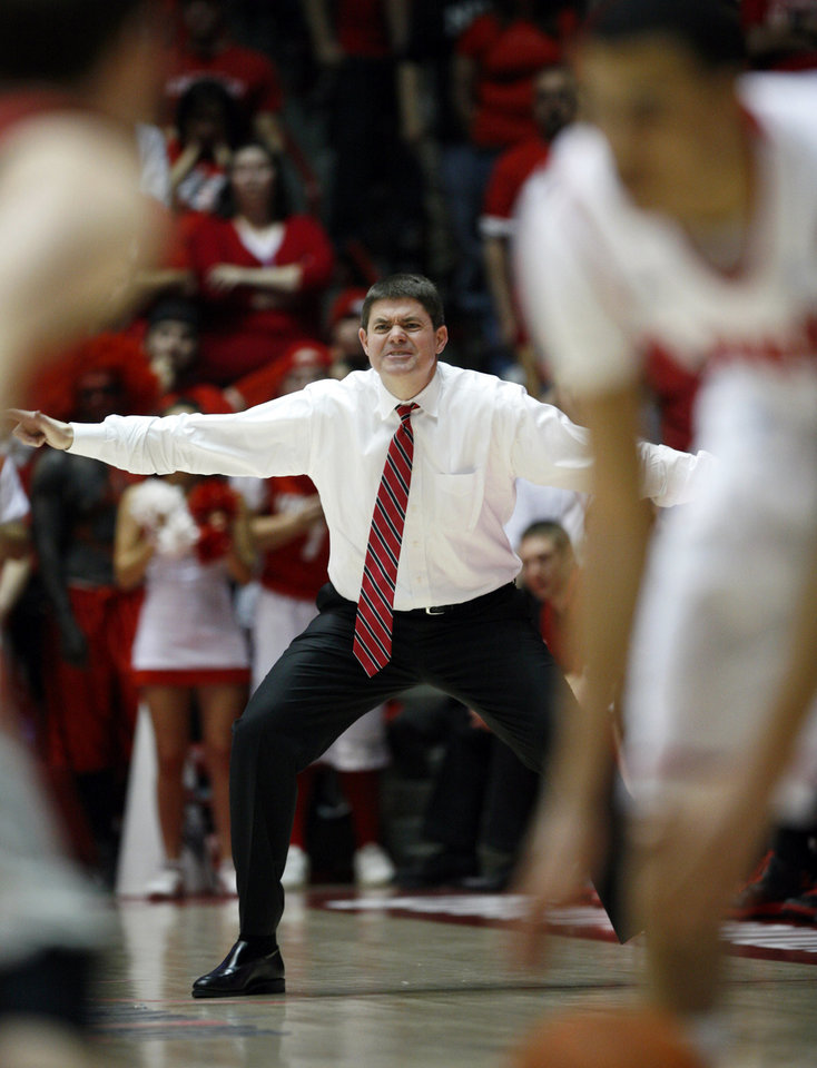 UNLV head coach Dave Rice relays a play to his players in the second half of a NCAA college basketball game against New Mexico at The Pit in Albuquerque, N.M., Saturday, Feb. 18, 2012. New Mexico won, 65-45. (AP Photo/Jake Schoellkopf) ORG XMIT: NMJS116