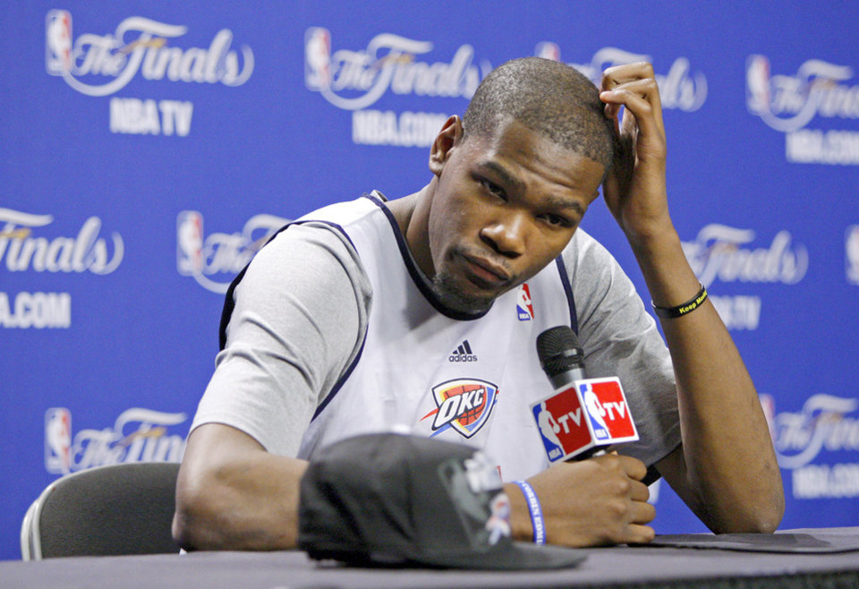Photo - Oklahoma City's Kevin Durant listens to a question during a press conference for Game 5 of the NBA Finals between the Oklahoma City Thunder and the Miami Heat at American Airlines Arena, Wednesday, June 20, 2012. Photo by Bryan Terry, The Oklahoman
