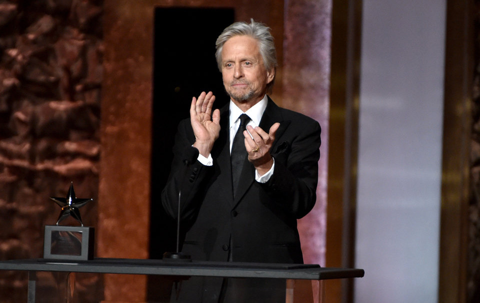 Photo - Michael Douglas presents the AFI Lifetime Achievement Award to Jane Fonda at the 42nd AFI Lifetime Achievement Award Tribute Gala at the Dolby Theatre on Thursday, June 5, 2014, in Los Angeles. (Photo by John ShearerInvision/AP)