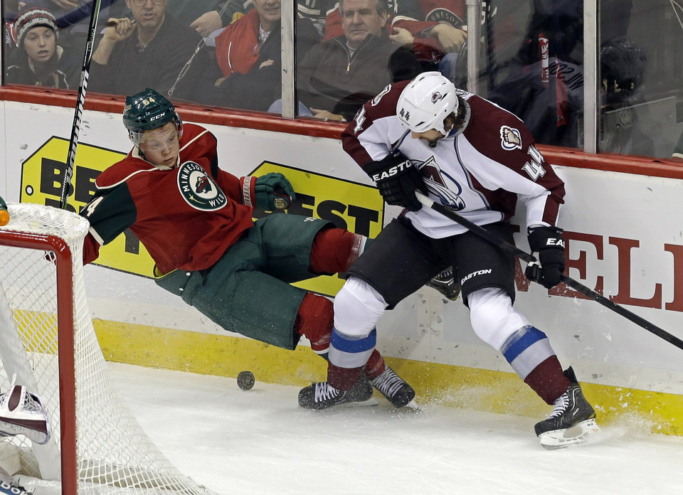 Minnesota Wild\'s Mikael Granlund of Finland, left, making his NHL debut, is upended by Colorado Avalanche\'s Ryan Wilson in a battle for the puck in the first period of an NHL hockey game Saturday, Jan. 19, 2013 in St. Paul, Minn. (AP Photo/Jim Mone)