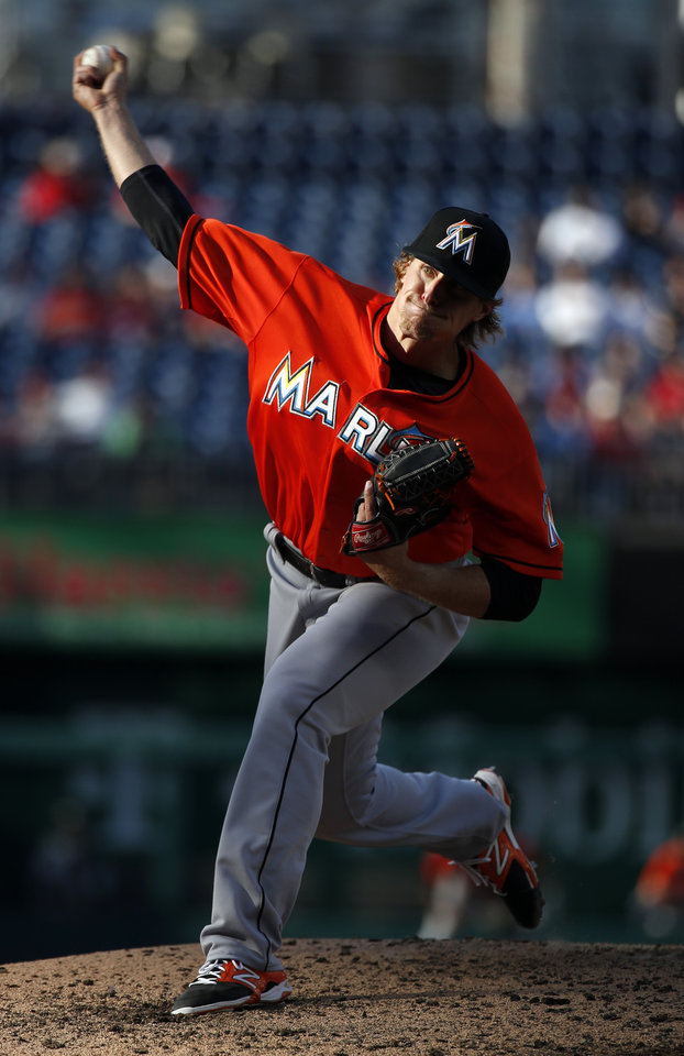Photo - Miami Marlins starting pitcher Tom Koehler throws during the fifth inning of a baseball game against the Washington Nationals at Nationals Park, Thursday, April 10, 2014, in Washington. (AP Photo/Alex Brandon)