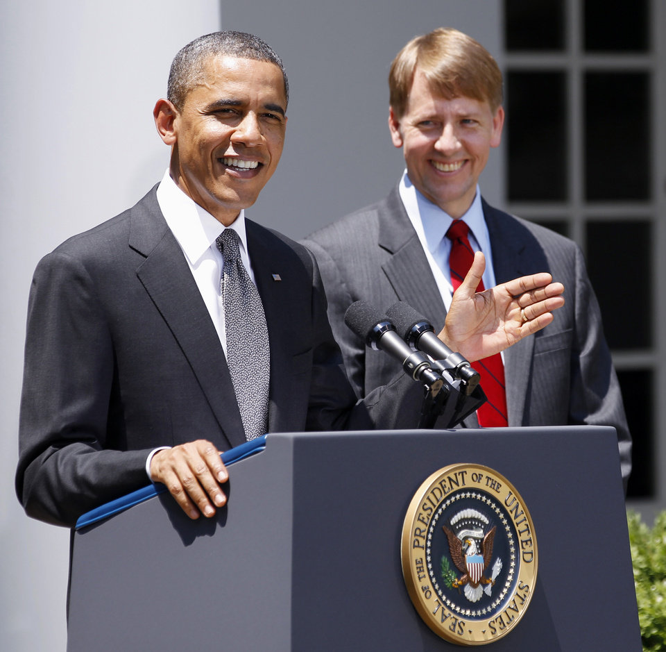 Photo -   FILE - In this July 18, 2011 file photo, President Barack Obama and presidential nominee to serve as the first director of the Consumer Financial Protection Bureau (CFPB), former Ohio Attorney General Richard Cordray are seen in the Rose Garden of the White House in Washington. America's decision to re-elect President Barack Obama over Republican presidential candidate, former Massachusetts Gov. Mitt Romney will impact key sectors of the American economy.The 2010 overhaul of financial rules marked a victory for Obama. Officials who are still carrying out the details of the law may now be more likely to take a tough stance. (AP Photo/Manuel Balce Ceneta, File)