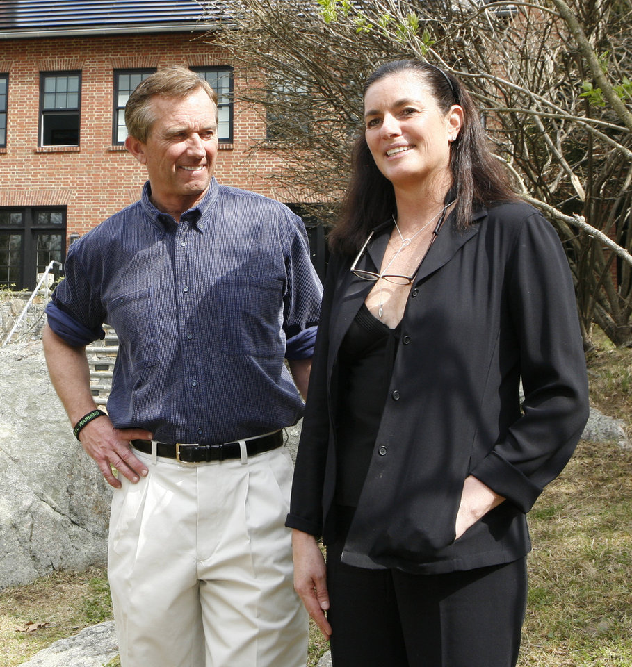 Photo -   In this photo of April 6, 2010, Robert Kennedy Jr. and his wife Mary Richardson Kennedy pose for a photo outside their Bedford, N.Y. home. The estranged wife of Robert Kennedy Jr. was found dead at the family property, Wednesday, May 16, 2012, adding to the list of Kennedy family tragedies. She was an architect and designer and had overseen the renovation of the couple's home into an environmentally advanced showpiece. (AP Photo/Mark Vergari, The Journal News)
