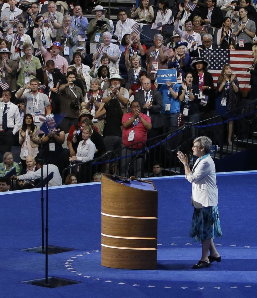 Photo - Sister Simone Campbell, Executive Director of the Roman Catholic Social Justice Organization, acknowledges applause after her speech at the Democratic National Convention in Charlotte, N.C., on Wednesday, Sept. 5, 2012. (AP Photo/Lynne Sladky)  ORG XMIT: DNC161