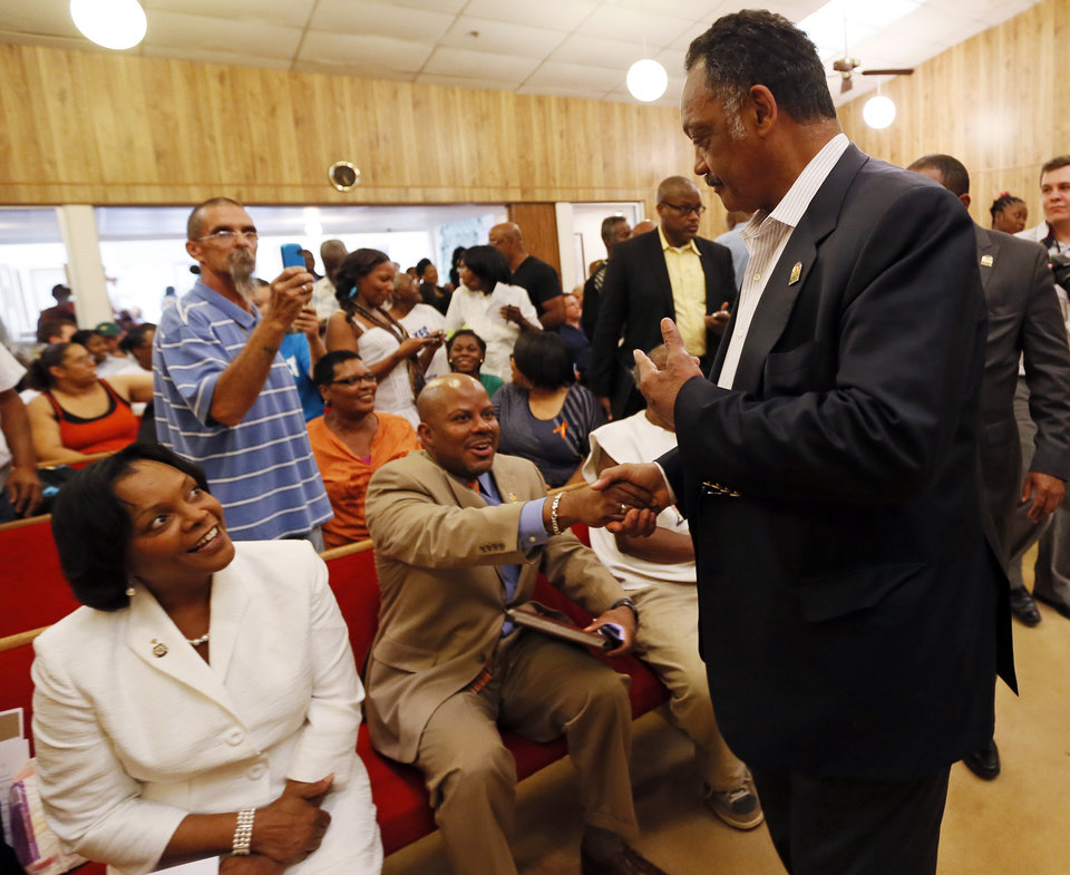 Photo - Rev. Jesse Jackson arrives at a rally in support of Darrell Williams at Mt. Zion Baptist Church in Stillwater, Okla., Thursday, Aug. 23, 2012. Williams, a suspended Oklahoma State basketball player, was found guilty on two counts of rape by instrumentation and one count of sexual battery after an incident at a house party. Photo by Nate Billings, The Oklahoman