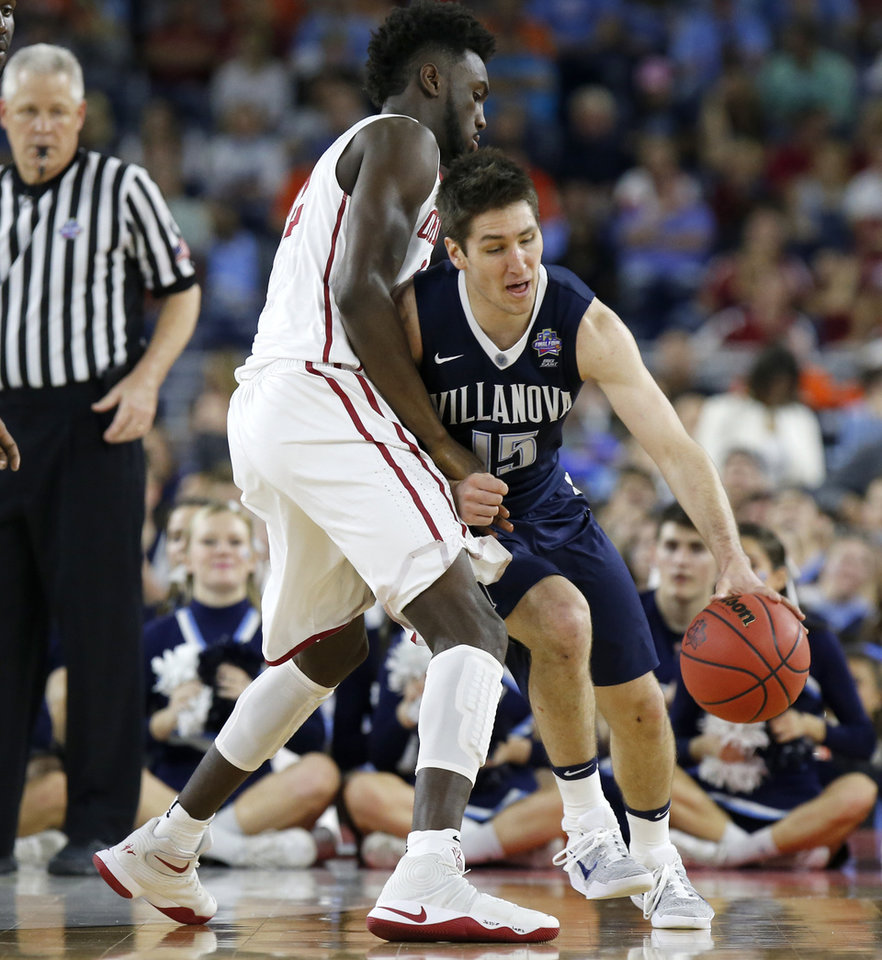 Photo - Oklahoma's Khadeem Lattin (12) defends Villanova's Ryan Arcidiacono (15) during the national semifinal between the Oklahoma Sooners (OU) and the Villanova Wildcats in the Final Four of the NCAA Men's Basketball Championship at NRG Stadium in Houston, Saturday, April 2, 2016. Photo by Nate Billings, The Oklahoman