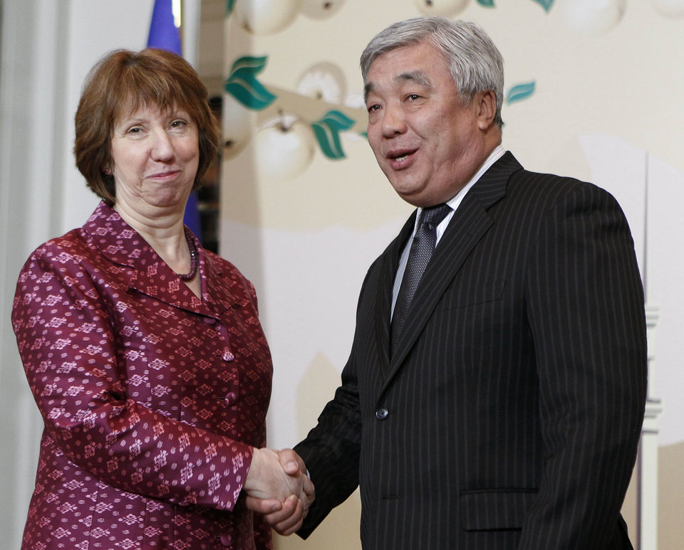 EU foreign policy chief Catherine Ashton, left, and Kazakhstan\'s Foreign Minister Yerlan Idrisov pose for the press in Almaty, largest Kazakhstan\'s city on Friday, April 5, 2013 at a start of high-level talks between world powers and Iranian officials. (AP Photo/ Shamil Zhumatov, Pool)