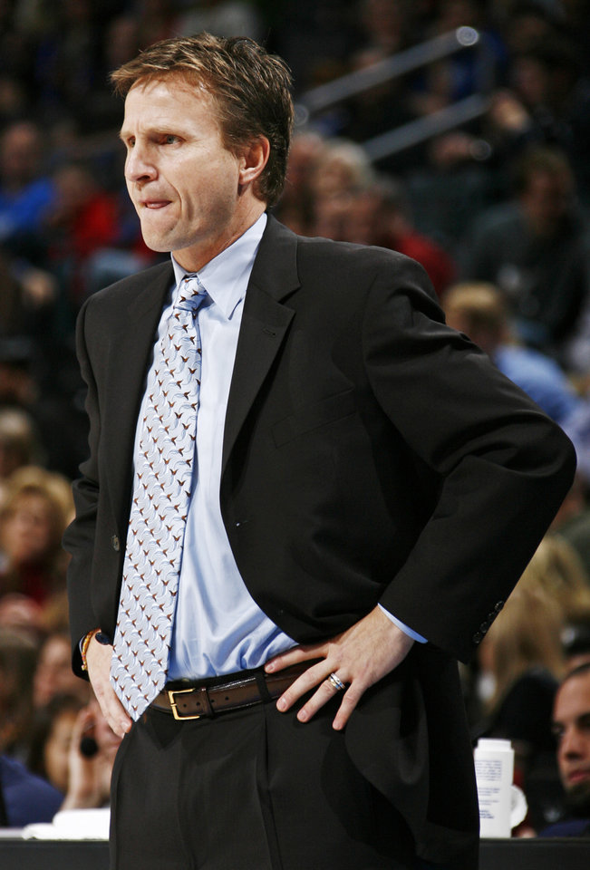 Photo - Oklahoma City head coach Scott Brooks watches his team during the NBA basketball game between the Golden State Warriors and the Oklahoma City Thunder at the Ford Center in Oklahoma City, Monday, December 8, 2008. BY NATE BILLINGS, THE OKLAHOMAN  ORG XMIT: KOD
