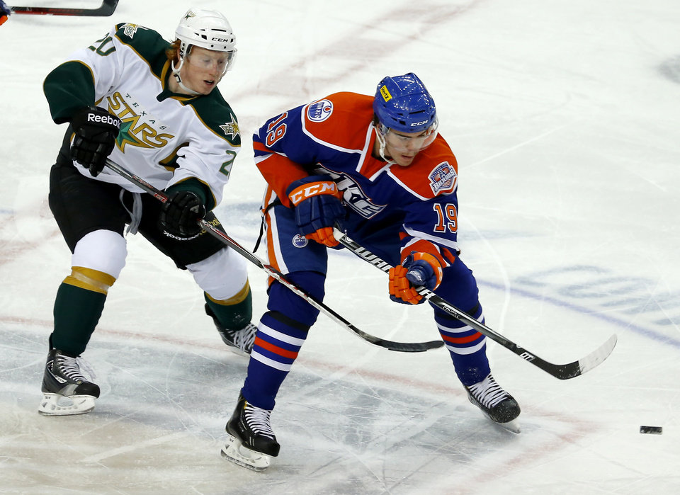 Magnus Paajarvi , at right, of the Oklahoma City Barons skates past Cody Eakin of the Texas Stars during an AHL hockey game at the Cox Convention Center in Oklahoma City, Friday, Dec. 21, 2012. Photo by Bryan Terry, The Oklahoman