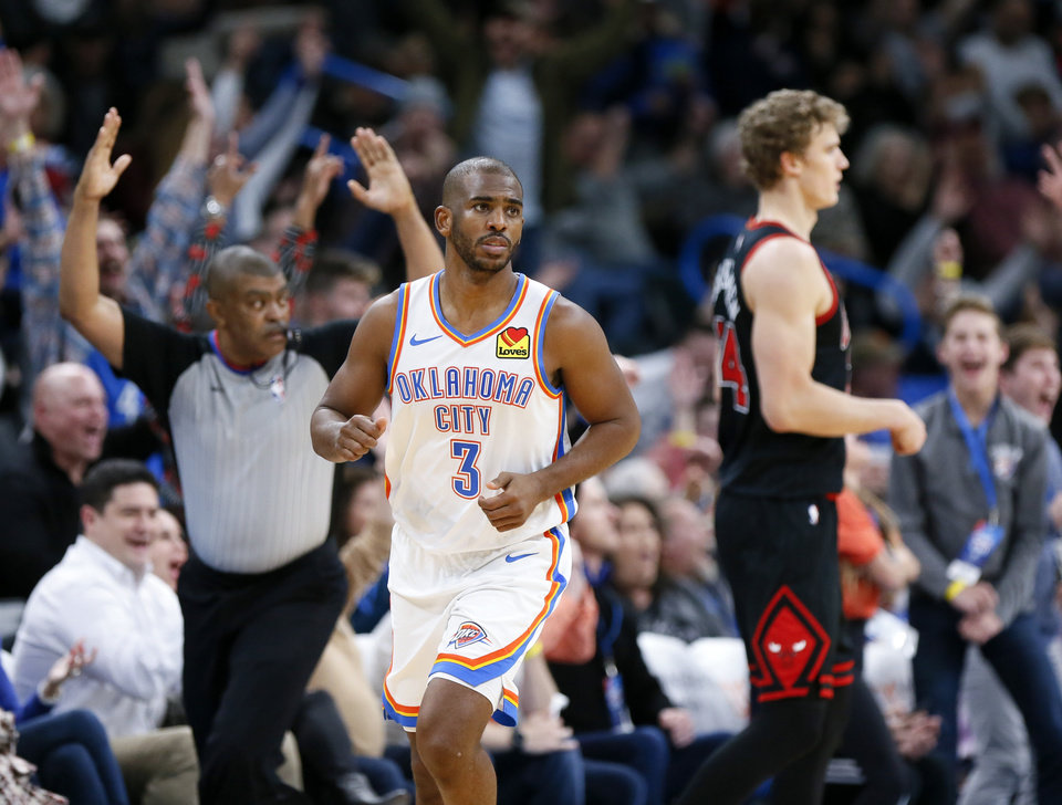 Photo - Oklahoma City's Chris Paul (3) runs back on defense after making a three-point shot in the fourth quarter during an NBA basketball game between the Oklahoma City Thunder and Chicago Bulls at Chesapeake Energy Arena in Oklahoma City, Monday, Dec. 16, 2019. Oklahoma City won 109-106. [Nate Billings/The Oklahoman]