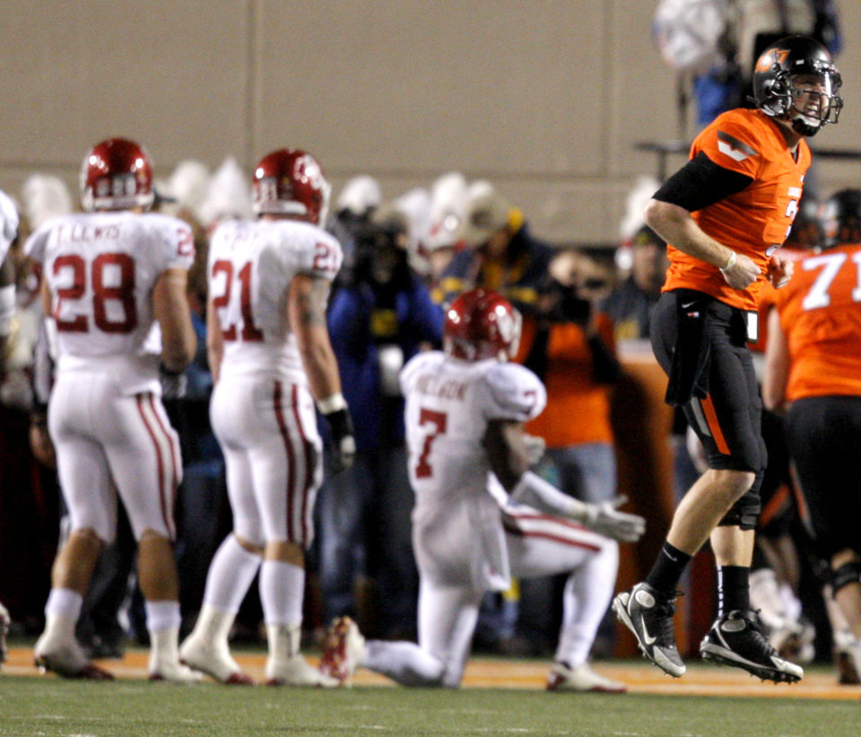 Oklahoma State\'s Brandon Weeden (3) celebrates a Cowboy touchdown during the Bedlam college football game between the Oklahoma State University Cowboys (OSU) and the University of Oklahoma Sooners (OU) at Boone Pickens Stadium in Stillwater, Okla., Saturday, Dec. 3, 2011. Photo by Sarah Phipps, The Oklahoman