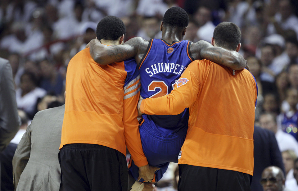 Photo -   New York Knicks' Iman Shumpert (21) is carried off the court after being injured in the second half during an NBA basketball game against the Miami Heat in the first round of the Eastern Conference playoffs in Miami, Saturday, April 28, 2012. The Heat defeated the Knicks 100-67. (AP Photo/Lynne Sladky)