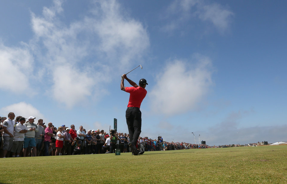 Photo - Tiger Woods of the US plays a shot off the 17th tee during the final round of the British Open Golf championship at the Royal Liverpool golf club, Hoylake, England, Sunday July 20, 2014. (AP Photo/Jon Super)