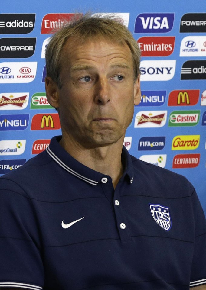 Photo - United States' head coach Jurgen Klinsmann attends a press conference before an official training session the day before the group G World Cup soccer match between Ghana and the United States at the Arena das Dunas in Natal, Brazil, Sunday, June 15, 2014. (AP Photo/Dolores Ochoa)