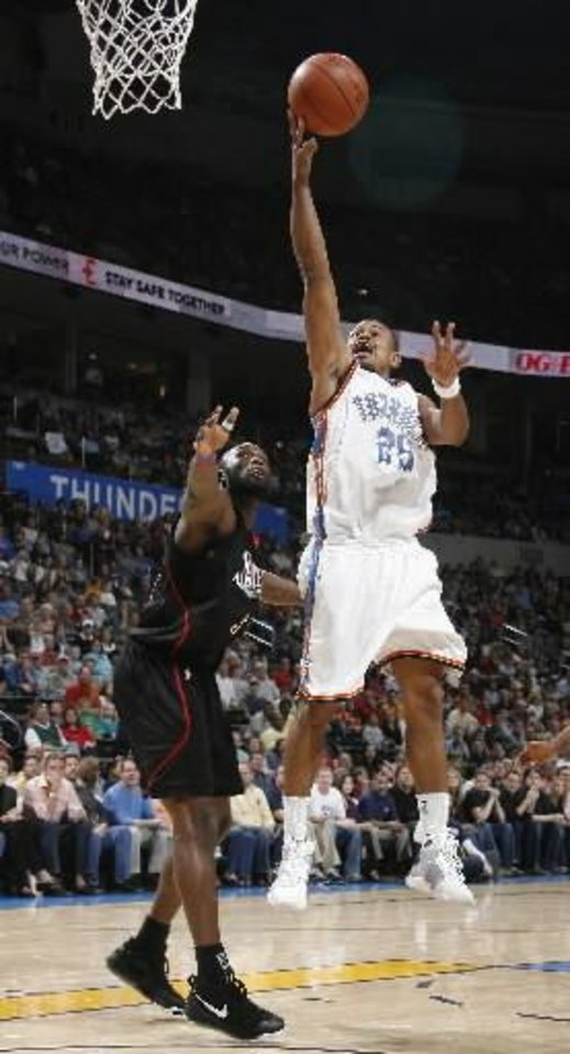 Earl Watson (25) shoots in front of Philadelphia\'s Reggie Evans (30) during the NBA basketball game between the Oklahoma City Thunder and Philadelphia 76ers at the Ford Center, Sunday, March 8, 2009, in Oklahoma City . PHOTO BY SARAH PHIPPS