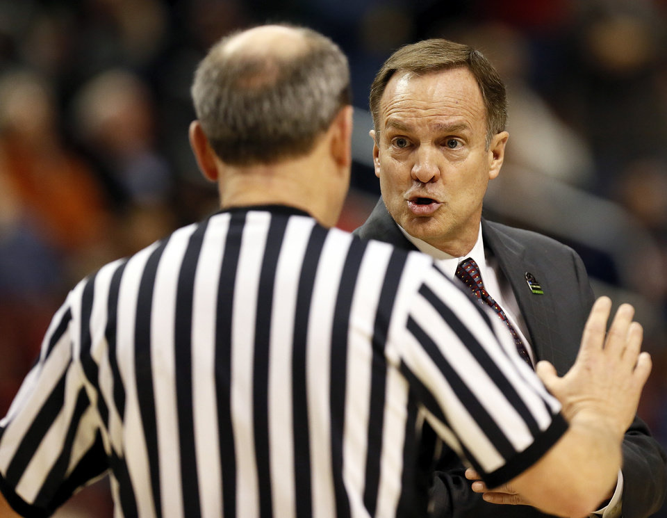 Photo - OU coach Lon Kruger argues with an official during a game between the University of Oklahoma and San Diego State in the second round of the NCAA men's college basketball tournament at the Wells Fargo Center in Philadelphia, Friday, March 22, 2013. San Diego State beat OU, 70-55. Photo by Nate Billings, The Oklahoman