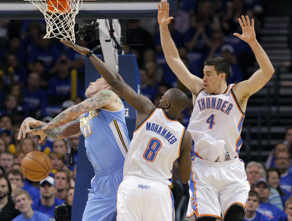 Photo - Oklahoma City's Nazr Mohammed (8) and Oklahoma City's Nick Collison (4) defend on Denver's Chris Andersen (11) during the first round NBA playoff game between the Oklahoma City Thunder and the Denver Nuggets on Sunday, April 17, 2011, in Oklahoma City, Okla. Photo by Chris Landsberger, The Oklahoman