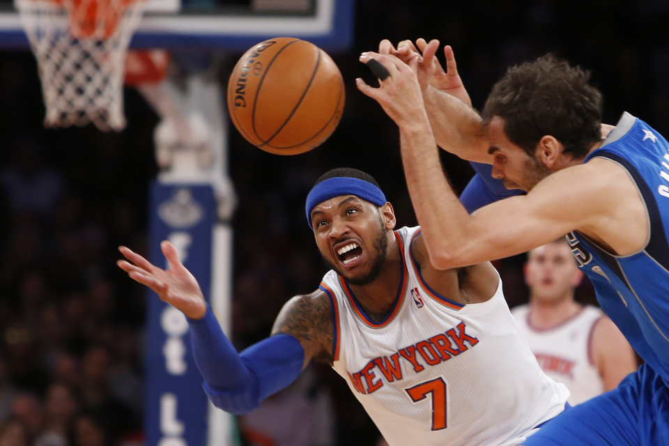 Photo - New York Knicks' Carmelo Anthony (7) fights for possession against Dallas Mavericks' Jose Calderon during the first half of an NBA basketball game, Monday, Feb. 24, 2014, in New York.  (AP Photo/Jason DeCrow)