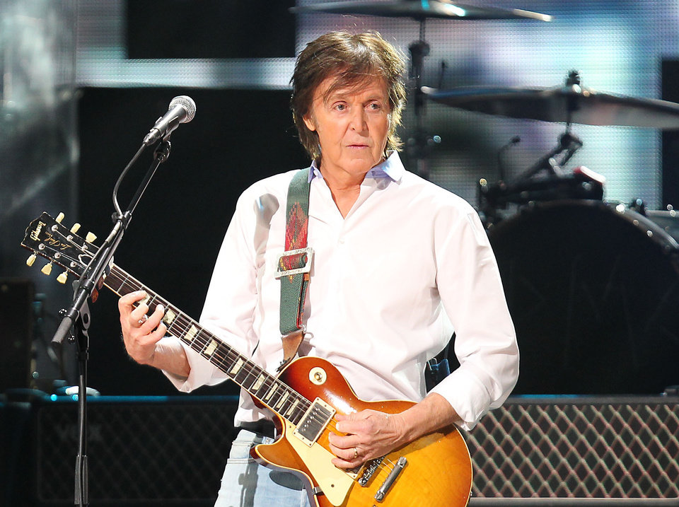 FILE - This Dec. 12, 2012 file image released by Starpix shows Paul McCartney at the 12-12-12 The Concert for Sandy Relief at Madison Square Garden in New York. McCartney and Mumford & Sons are among the headliners for the 2013 Bonnaroo Music & Arts Festival in Manchester, Tenn. The four-day festival, held on a rural 700-acre farm, will be held June 13-16, 2013. (AP Photo/Starpix, Dave Allocca, file)