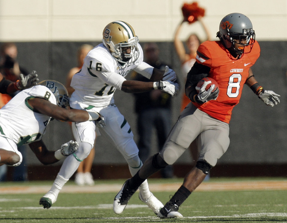 OSU's Daytawion Lowe (8) breaks away from Tevin Reese (16) and Glasco Martin (8) of Baylor as he returns an interception in the second quarter during a college football game between the Oklahoma State University Cowboys (OSU) and the Baylor University Bears (BU) at Boone Pickens Stadium in Stillwater, Okla., Saturday, Oct. 29, 2011. Photo by Nate Billings, The Oklahoman