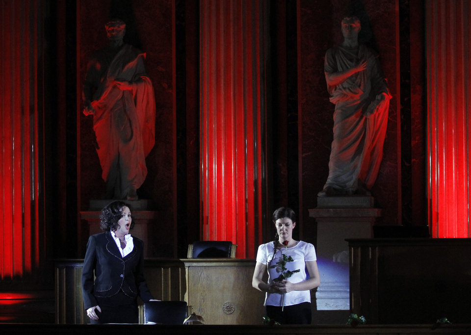 Photo - TO GO WITH HOLOCAUST OPERA STORY BY GEORGE JAHN -   Katerina Beranova and Silke Doerner, from left, perform during the holocaust opera  'Spiegelgrund ' by Austrian composer Peter Androsch in the imperial council hall of the Austrian parliament in Vienna, Friday, Jan. 25, 2013. Androsch goes where few others have dared, with an opera depicting how Nazis methodically killed mentally or physically deficient children. The performance premieres to mark International Holocaust Day in the parliament of Austria, a nation still atoning for its role in atrocities committed by the Nazis. (AP Photo/Ronald Zak)