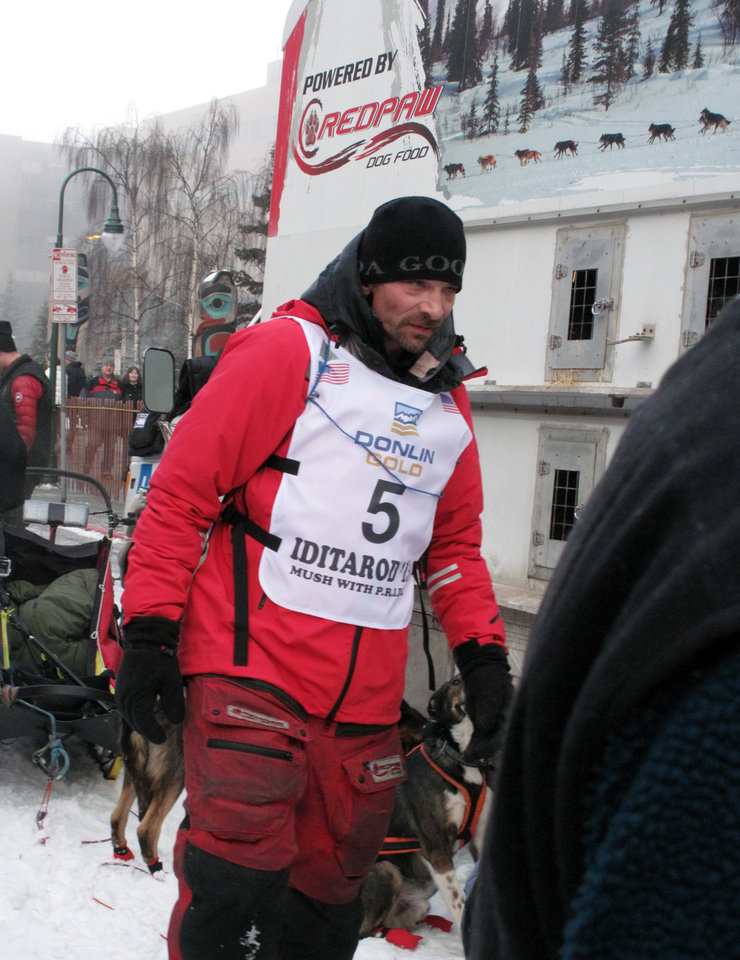 Photo - Four-time champion Lance Mackey prepares to take part in the ceremonial start of the Iditarod Trail Sled Dog Race Saturday, March 2, 2013, in Anchorage, Alaska. The competitive portion of the 1,000-mile race is scheduled to begin Sunday in Willow, 50 miles to the north. (AP Photo/Rachel D'Oro)