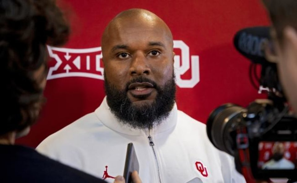 Photo -  New OU assistant coach Jamar Cain, who joined the Sooners from New Mexico State, speaks to reporters Wednesday in Norman. [Chris Landsberger/The Oklahoman]