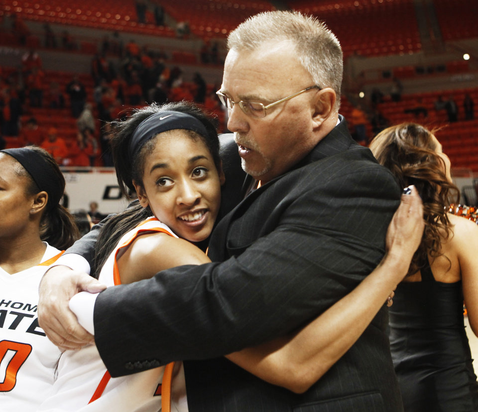 Photo - Oklahoma State's Tiffany Bias (3) hugs coach Jim Littell after an NCAA girl's college basketball game between Oklahoma State University (OSU) and Kansas State at Gallagher-Iba Arena in Stillwater, Okla., Saturday, March 1, 2014. Oklahoma State defeated Kansas State in 67-62 with Bias leading Oklahoma State at 17 points on her final game in Stillwater. Photo by KT King, The Oklahoman