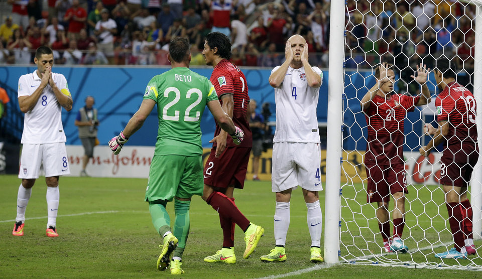 Photo - United States' Michael Bradley (4) reacts after his shot on an open goal was blocked by Portugal's Ricardo Costa (13) during the group G World Cup soccer match between the USA and Portugal at the Arena da Amazonia in Manaus, Brazil, Sunday, June 22, 2014. (AP Photo/Martin Mejia)