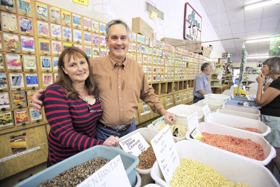 Photo - Horn Seed Co. owners Beverly and David Shumake at their seed counter. A devastating fire and a second summer of extreme heat convinced the couple to close the business after 91 years.  Steve Gooch - The Oklahoman