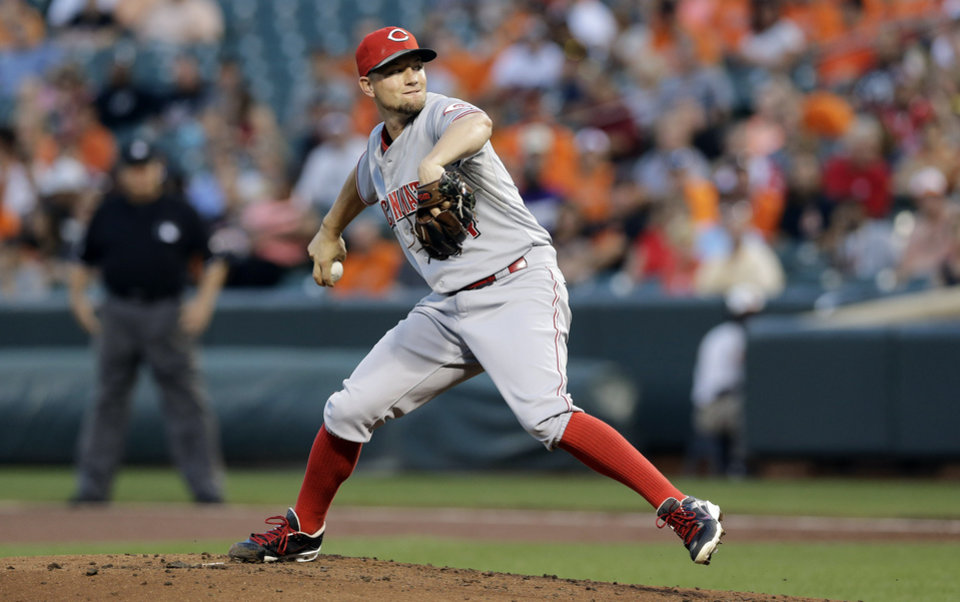 Photo - Cincinnati Reds starting pitcher Mike Leake throws to the Baltimore Orioles in the first inning of an interleague baseball game, Thursday, Sept. 4, 2014, in Baltimore. (AP Photo/Patrick Semansky)