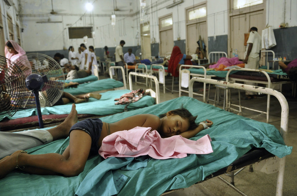 Photo - Indian children who fell sick after eating a free school lunch lie at a hospital in Patna, India, Wednesday, July 17, 2013. At least 22 children died and more than two dozen others were sick after eating a free school lunch that was tainted with insecticide, Indian officials said Wednesday. (AP Photo/Aftab Alam Siddiqui)