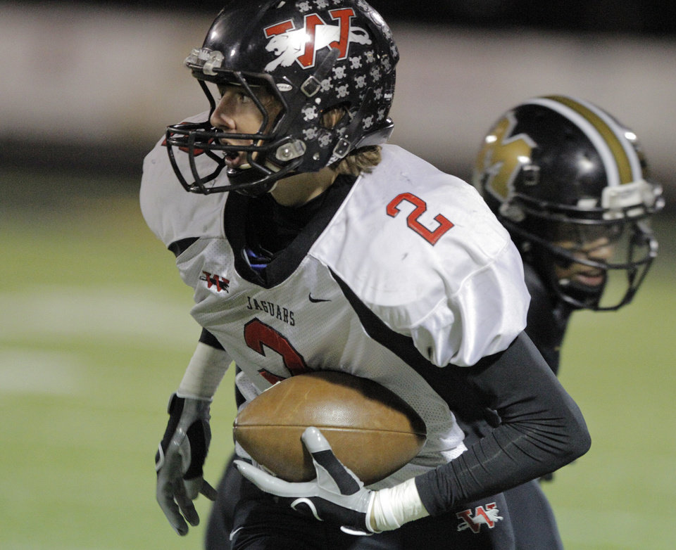 Photo - Westmoore's Austin Bowling (2) during a high school football game between Midwest City and Westmoore in Midwest City, Friday, Nov. 11, 2011.  Photo by Garett Fisbeck, for The Oklahoman ORG