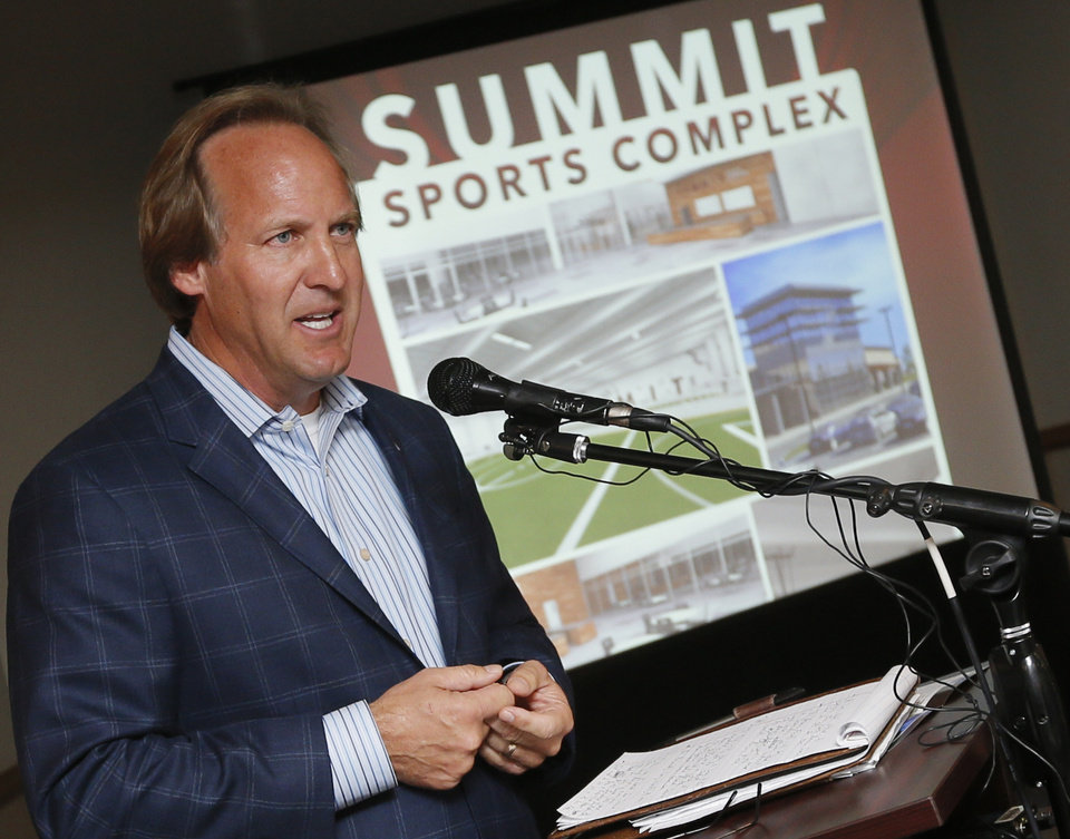 Photo - Tim McLaughlin speaks during the unveiling of the Summit Sports Complex at the Edmond Community Center, 28 E Main St., in Edmond, Okla., Wednesday, Oct. 9, 2013. The Summit Sports Complex will be located at I-35 and Covell. The grand opening is projected to be summer of 2015. Photo by Nate Billings, The Oklahoman