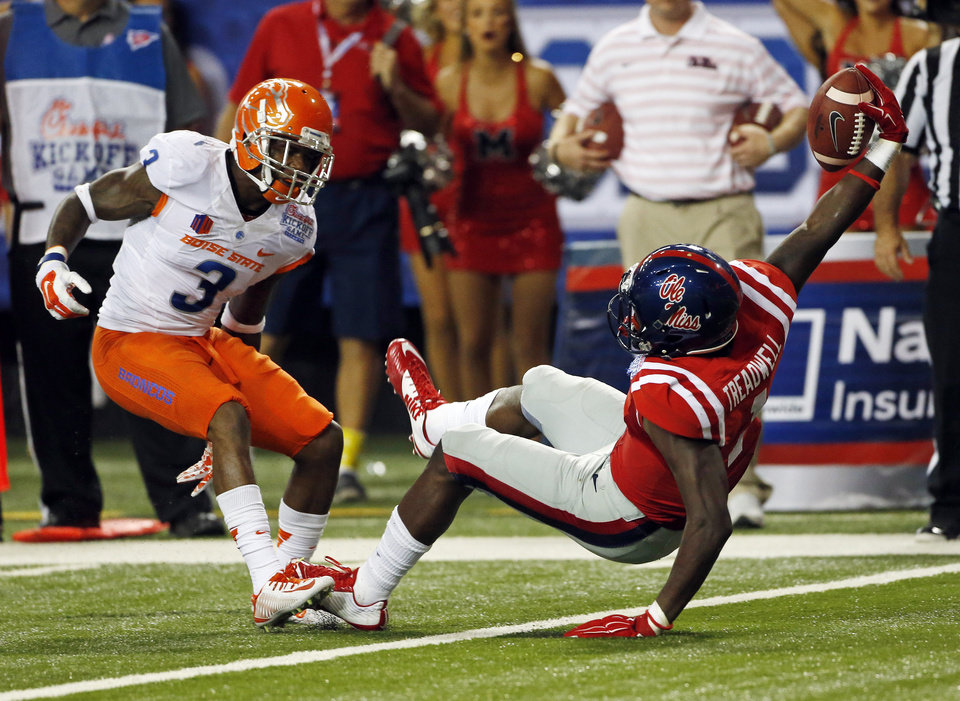 Photo - Mississippi wide receiver Laquon Treadwell (1) reaches for the end zone as he scores on a pass as Boise State cornerback Cleshawn Page (3) defends in the in the second half of an NCAA college football game  Thursday, Aug. 28, 2014, in Atlanta.  (AP Photo/John Bazemore)