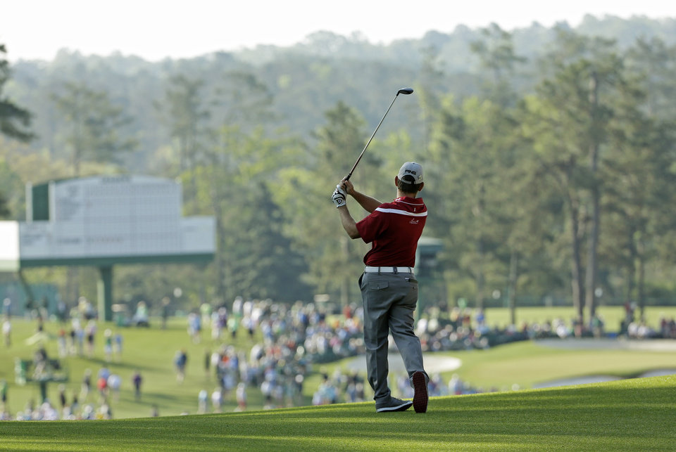 Photo - Louis Oosthuizen, of South Africa, watches his second shot on the second hole during the second round of the Masters golf tournament Friday, April 11, 2014, in Augusta, Ga. (AP Photo/David J. Phillip)