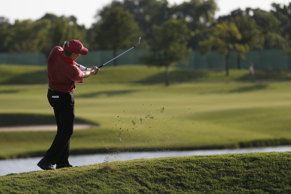 Photo - Gil Morgan hits on the 14th hole during the U.S. Senior Open golf tournament at Oak Tree National in Edmond, Okla., Thursday, July 10, 2014. Photo by Sarah Phipps, The Oklahoman