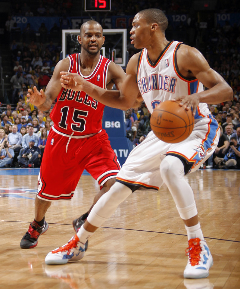 Photo - Oklahoma City's Russell Westbrook (0) looks to get past Chicago's John Lucas (15) during the NBA basketball game between the Chicago Bulls and the Oklahoma City Thunder at Chesapeake Energy Arena in Oklahoma City, Sunday, April 1, 2012. Photo by Sarah Phipps, The Oklahoman