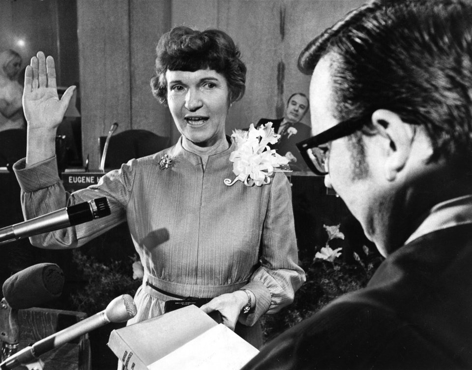 Mrs. Patience Latting takes the oath of office in the City Council chambers as she becomes the first woman mayor in the history of Oklahoma City.  Presiding Municipal Judge Phillip Lambert administers the oath. Staff photo by Jim Argo taken 4/13/71; photo ran in the 3/20/83 Daily Oklahoman.