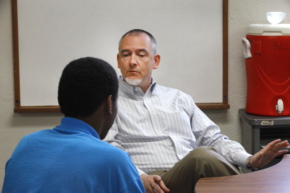 Photo -  Left:  Superintendent Jerry Fry talks to a youth in the Tecumseh center.  PhotoS by David McDaniel,  The Oklahoma    Central Oklahoma Juvenile Center in Tecumseh for a story about how the center's use of force policies have changed, Thursday, April 10, 2014. Photo by David McDaniel, The Oklahoman      David McDaniel - The Oklahoman