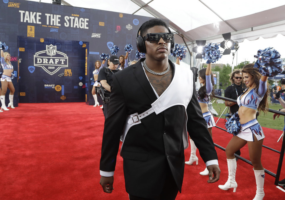 Photo - Michigan linebacker Devin Bush walks the red carpet ahead of the first round at the NFL football draft, Thursday, April 25, 2019, in Nashville, Tenn. (AP Photo/Steve Helber)