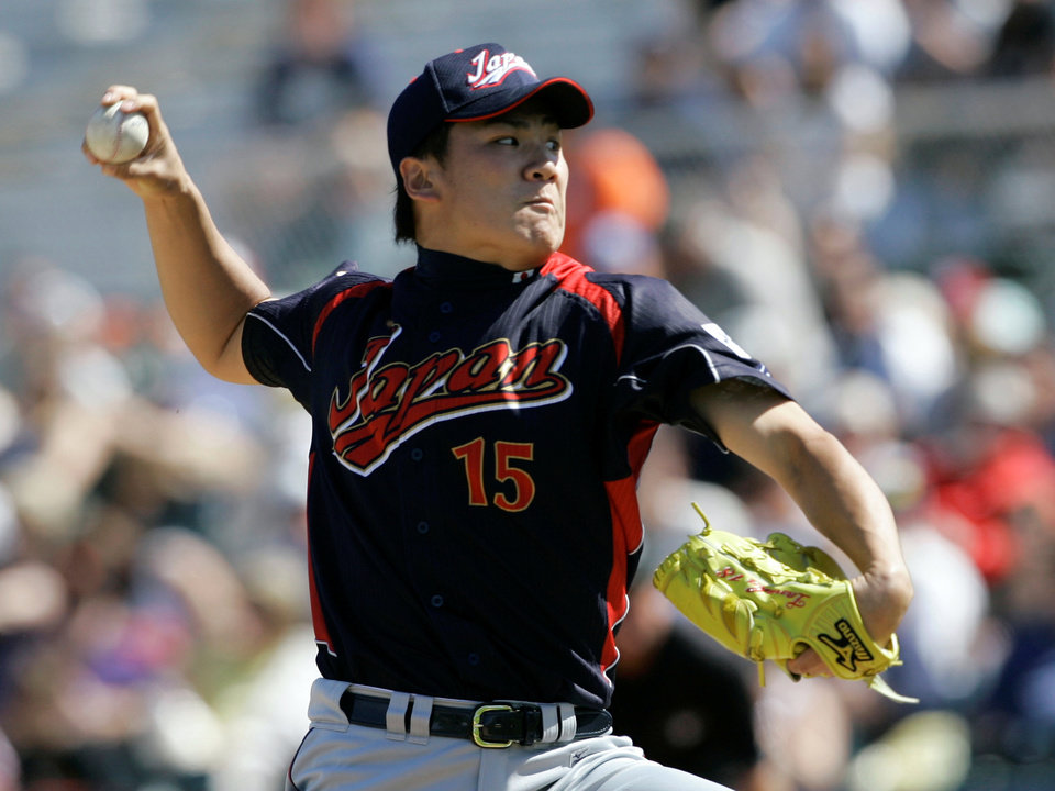 Photo - FILE - In this March 11, 2009, file photo, Japan's Masahiro Tanaka pitches to the San Francisco Giants during an exhibition baseball game in Scottsdale, Ariz. The New York Yankees and Tanaka agreed on Wednesday, Jan. 22, 2014, to a $155 million, seven-year contract. In addition to the deal with the pitcher, the Yankees must pay a $20 million fee to the Japanese team of the 25-year-old right-hander, the Rakuten Golden Eagles. (AP Photo/Jeff Chiu, File)