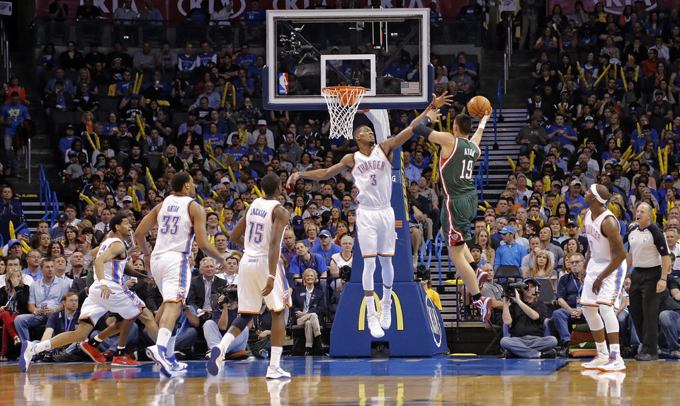Photo - Oklahoma City's Perry Jones (3) defends on Milwaukee's Gustavo Ayon (19) during the season finale NBA basketball game between the Oklahoma City Thunder and the Milwaukee Bucks at Chesapeake Energy Arena on Wednesday, April 17, 2013, in Oklahoma City, Okla.   Photo by Chris Landsberger, The Oklahoman