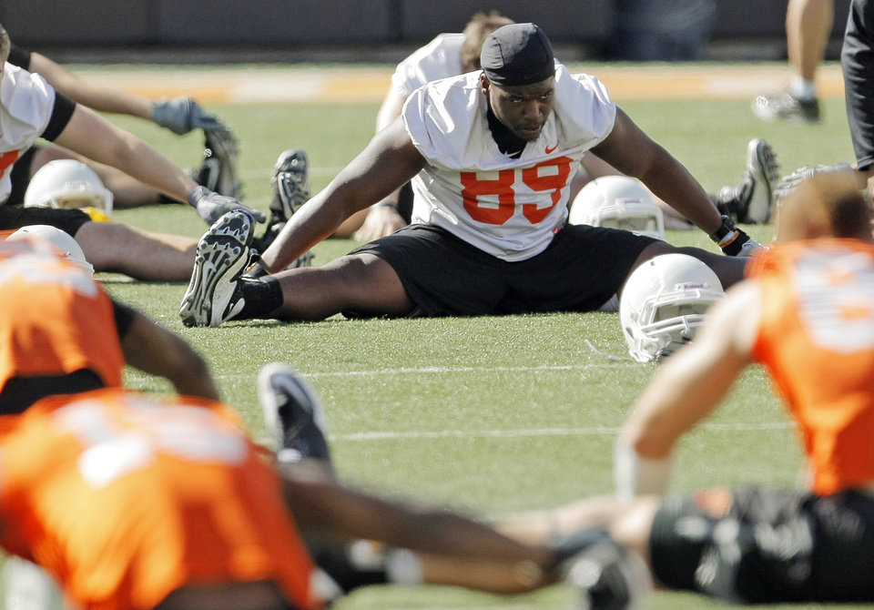 Photo - The OSU Cowboys, including Nigel Nicholas (89), stretch during spring football practice at Boone Pickens Stadium on the campus of Oklahoma State University in Stillwater, Okla., Monday, March 12, 2012. Photo by Nate Billings, The Oklahoman