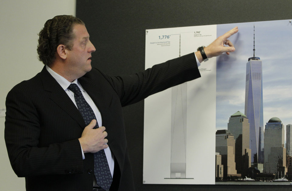Photo - Timothy Johnson, chairman of the Council on Tall Buildings and Urban Habitat, speaks about the determination of 1 World Trade Center as the tallest building in the United States, Tuesday, Nov. 12, 2013, in New York. The council determined that when it is completed and occupied, One World Trade Center, at 1776 feet, will be the tallest building over Chicago's Willis Tower. (AP Photo/Kathy Willens)