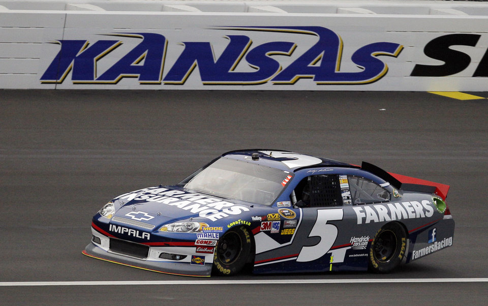 Photo -   Driver Kasey Kahne (5) takes a lap during qualifying for Sunday's NASCAR Sprint Cup Series auto race at Kansas Speedway in Kansas City, Kan., Friday, Oct. 19, 2012. Kahne won the pole position for Sunday's race with a speed of 191.360 mph. (AP Photo/Orlin Wagner)