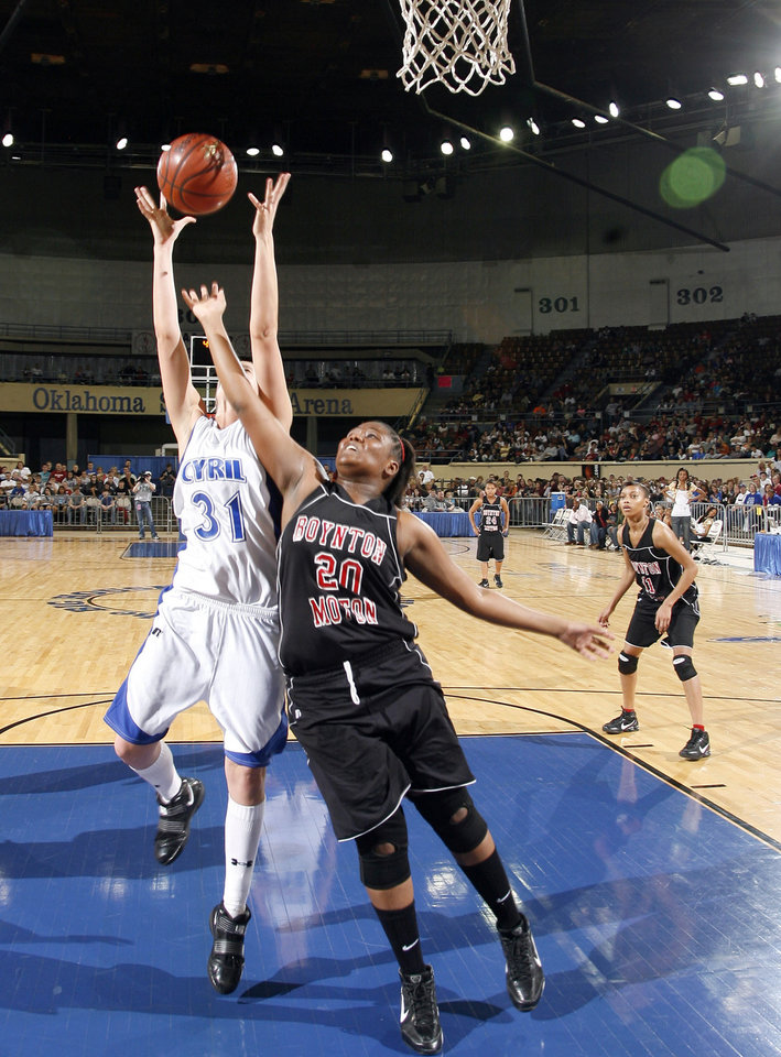 Photo - Boyton-Moton's Shawonda Lang (2) blocks Cyril's Emily Horton's shot during the final of the Class B girls basketball state tournament  between Cyril and Boynton-Moton at the State Fair Arena, Saturday, March 6, 2010, in Oklahoma City. Photo by Sarah Phipps, The Oklahoman