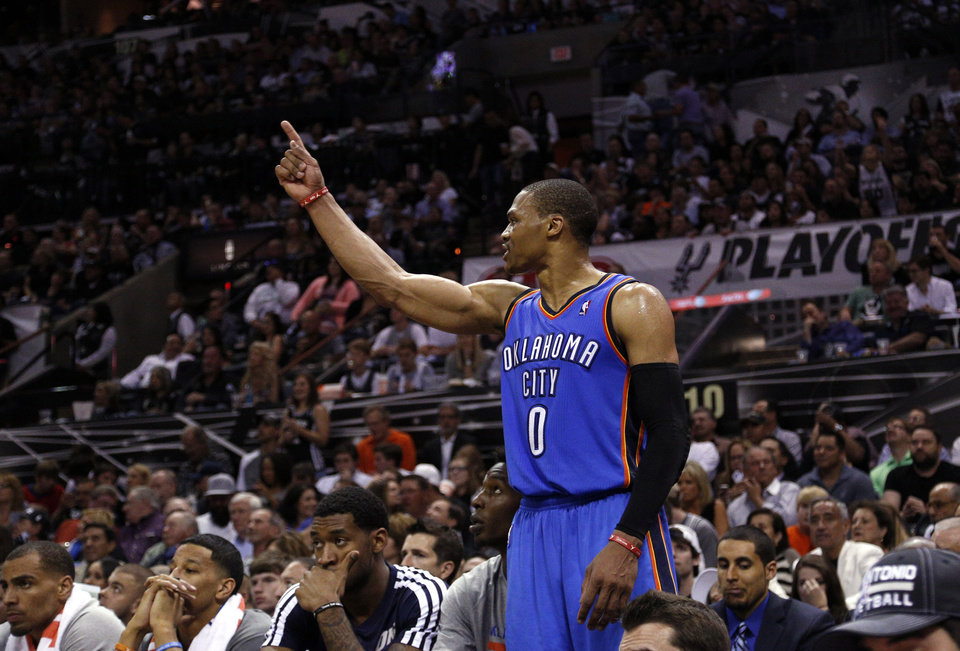 Photo - Oklahoma City's Russell Westbrook (0) argues a call from the bench during Game 2 of the Western Conference Finals in the NBA playoffs between the Oklahoma City Thunder and the San Antonio Spurs at the AT&T Center in San Antonio, Wednesday, May 21, 2014. Photo by Sarah Phipps