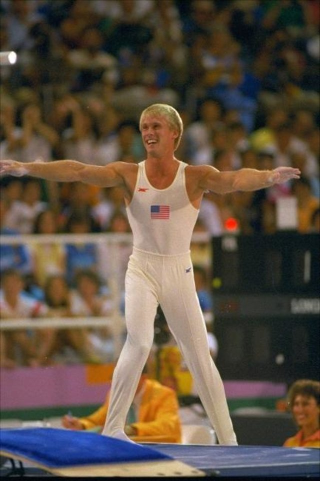 Photo -  Bart Conner dismounts during the Los Angeles Olympics in 1984. [AP FILE PHOTO]
